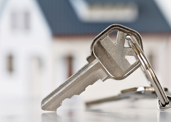 key and paperwork for real estate